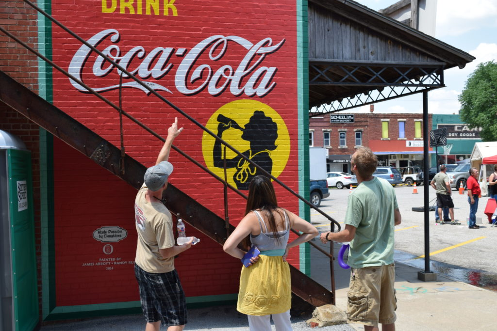 Tourists Are Drawn To Town To See Restored Advertising Art Adorning Buildings In Downtown Berryville
